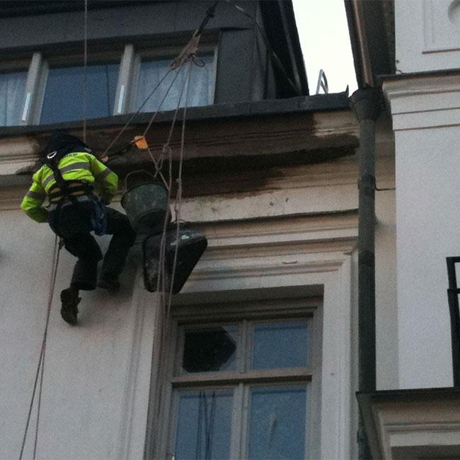 laga puts på fasad i Stockholm